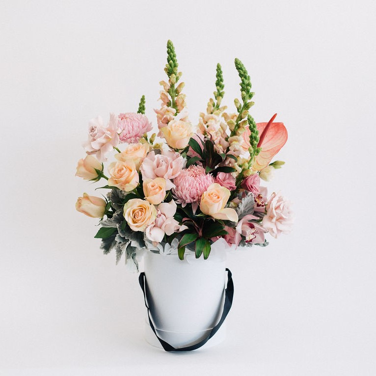 Gianna - premium hatbox flower arrangement featuring roses, snapdragons, disbuds and orchids for Melbourne same day delivery.