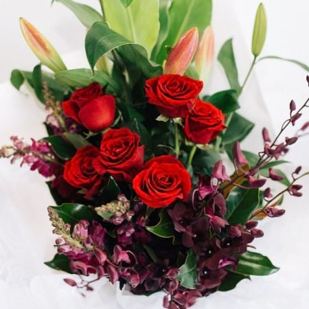 Leila - rich opulent bouquet of red roses, eggplant purple orchids, purple snapdragons and pink oriental lilies, Melbourne delivery only.